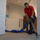 A ClearPro team member cleans this rental property's carpets as part of our Scottsdale rental property cleaning services.